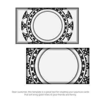 Conception de carte de visite couleurs blanches avec ornement de mandala noir. cartes de visite élégantes avec un espace pour votre texte et des motifs grecs.