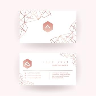 Conception de carte de visite en or rose de luxe avec un style géométrique