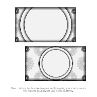 Conception de carte de visite prête à imprimer couleurs blanches avec mandalas. modèle de carte de visite avec place pour votre texte et ornements noirs.