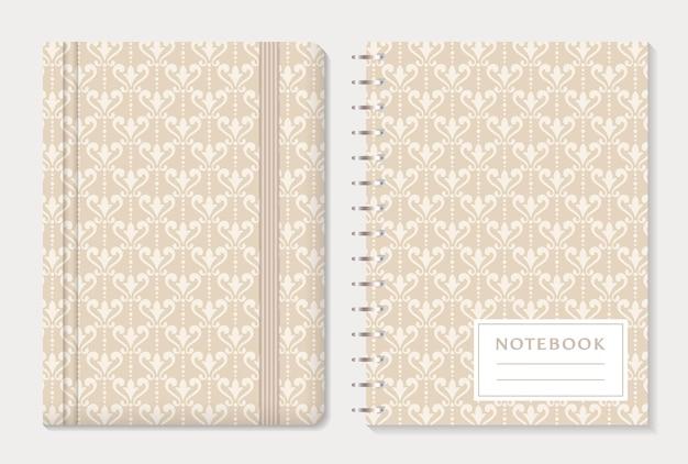 Conception de couverture de cahier avec des motifs damassés.