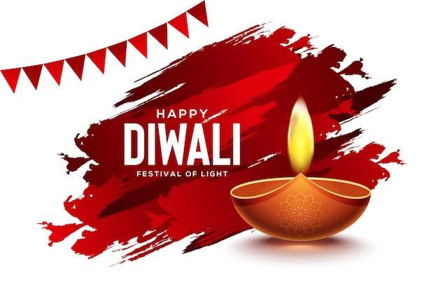 Conception heureuse de diwali avec des éléments de lampe à huile diya sur fond de coup de pinceau rouge
