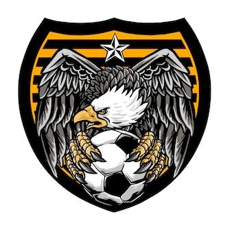 Conception d'insigne d'aigle avec ballon de football