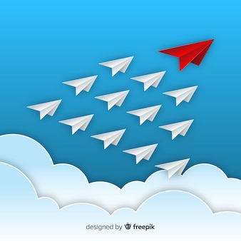 Conception de leadership avec des avions en papier