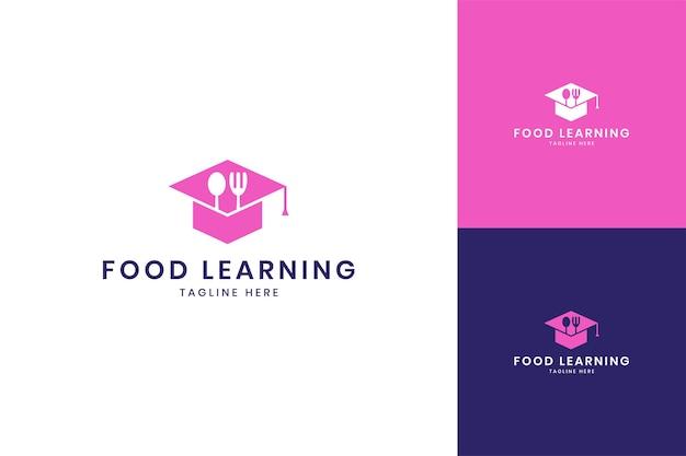 Conception de logo d'espace négatif d'apprentissage de la nourriture