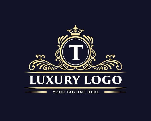Conception de logo de luxe de style vintage antique monogramme dessiné main floral calligraphique doré avec couronne