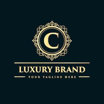 Conception de logo de luxe de style vintage antique monogramme dessiné main floral calligraphique doré