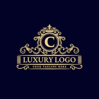 Conception de logo de luxe de style vintage antique monogramme héraldique dessiné main floral calligraphique or floral