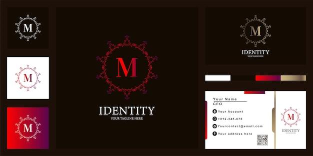 Conception de modèle de logo de cadre de fleur d'ornement de luxe lettre m avec carte de visite.