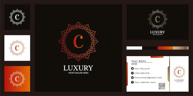 Conception de modèle de logo lettre c luxe ornement fleur cadre avec carte de visite.