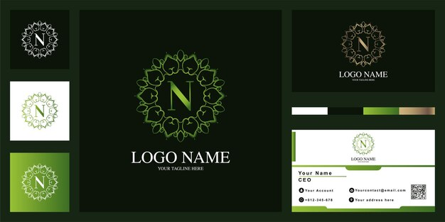 Conception de modèle de logo lettre n luxe ornement fleur cadre avec carte de visite.
