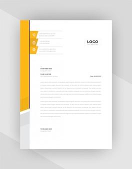 Conception de modèle de papier à en-tête jaune et noir.