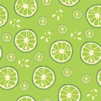 Conception de modèle sans couture de fruits avec des morceaux de citron vert.