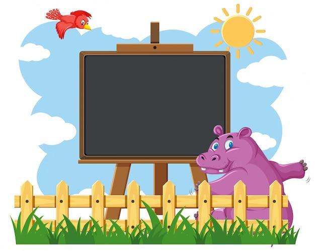 Conception de modèle de tableau noir avec hippopotame heureux dans le jardin