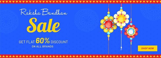 Conception d'en-tête ou de bannière de vente de raksha bandhan avec une offre de remise de 60 et un accrochage floral de rakhis