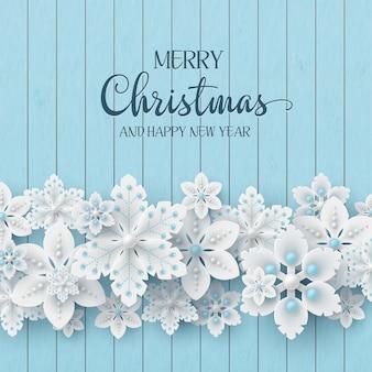 Conception de vacances de noël. flocons de neige décoratifs 3d avec ombre et perles sur fond de texture en bois avec texte d'accueil. illustration vectorielle.