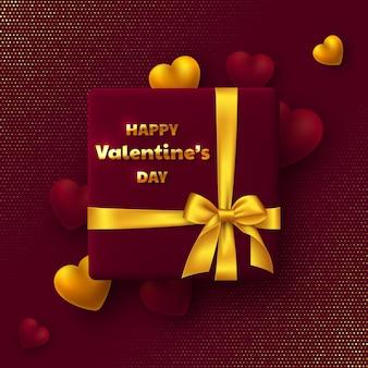 Conception de vacances de la saint-valentin. coffret cadeau avec noeud doré, coeurs 3d et salutation.