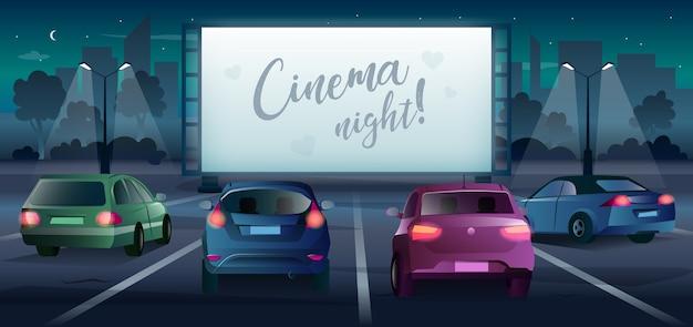 Conduisez dans une salle de cinéma avec grand écran et voitures