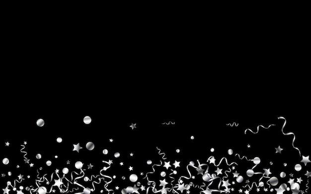 Confettis argent volant sur fond noir