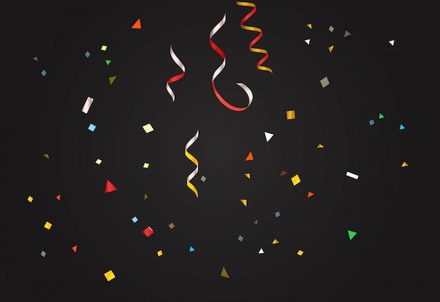 Confettis colorés sur fond sombre.