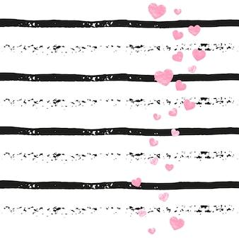 Confettis de paillettes de mariage avec des coeurs sur des rayures noires. paillettes aux reflets et paillettes métalliques.