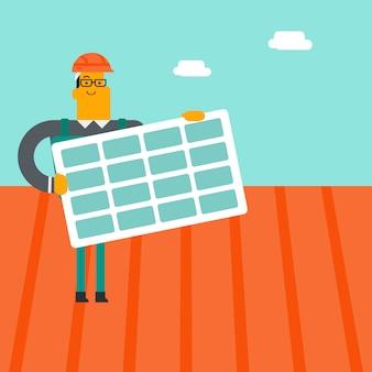 Un constructeur blanc caucasien installe un panneau solaire