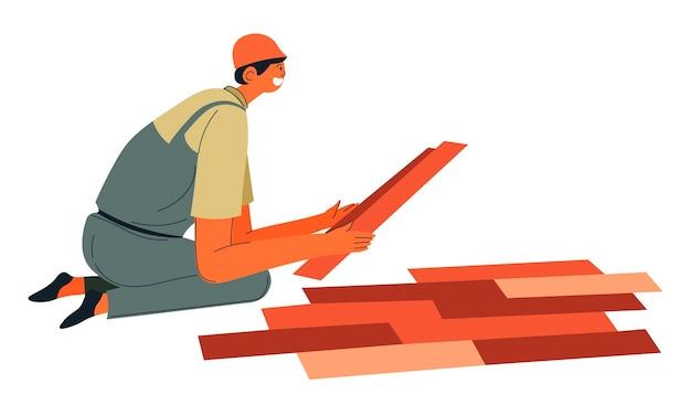 Constructeur rénovant le sol, posant le vecteur de parquet