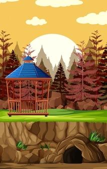 Construction d'un parc animalier sans animal sur fond de coucher de soleil en style cartoon