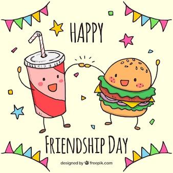 Contexte de l'amitié avec hamburger et boisson