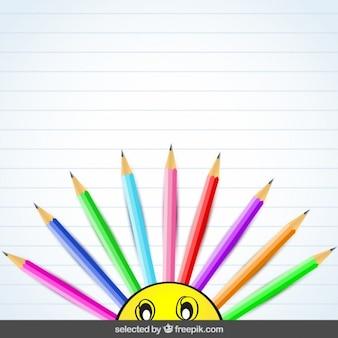 Contexte avec des crayons colorés et émoticône