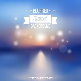 Contexte du coucher du soleil brouillé avec effet bokeh