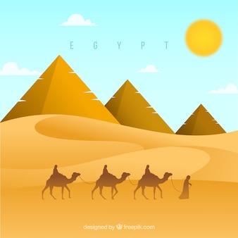Contexte du paysage des pyramides d'egypte avec la caravane de chameaux