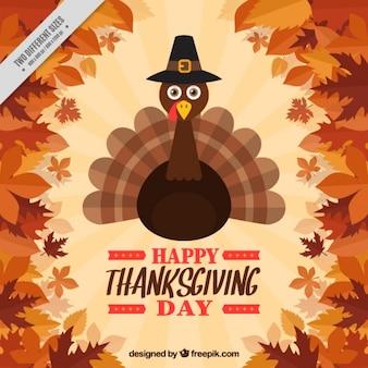 Contexte de feuilles avec une belle dinde de thanksgiving