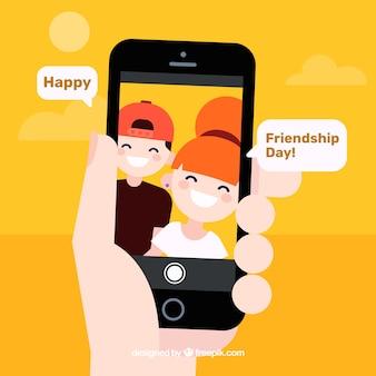 Contexte de jour de l'amitié avec mobile