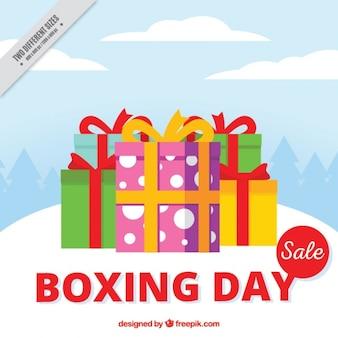 Contexte de la journée de boxe avec des cadeaux colorés