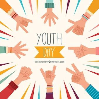 Contexte de la journée de la jeunesse avec les mains dans un design plat