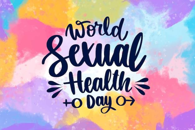 Contexte de la journée mondiale de la santé sexuelle avec des taches colorées