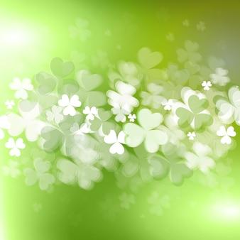 Contexte pour la saint patircks day avec des feuilles de trèfle brillant ou de trèfle