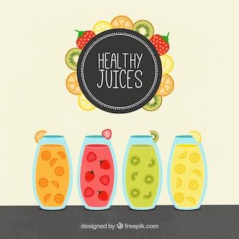 Contexte avec quatre jus de fruits sains