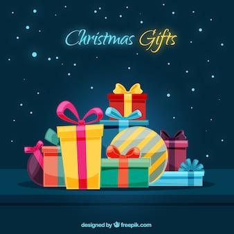 Contexte avec la variété de cadeaux de noël