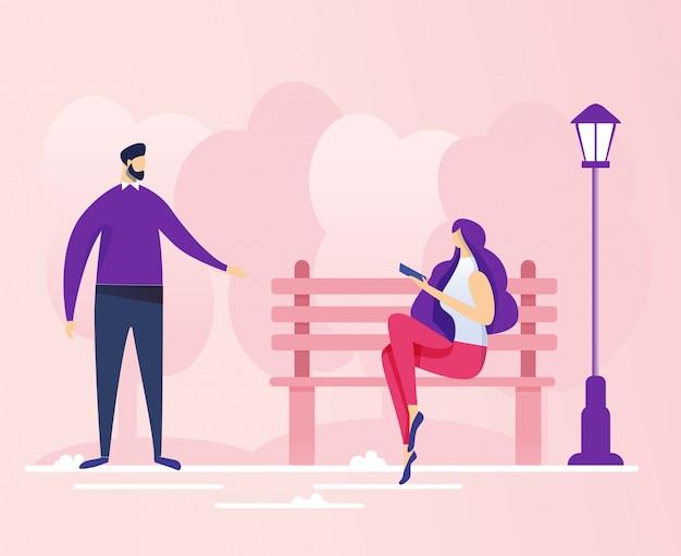 Conversation entre un jeune homme et une femme dans un parc