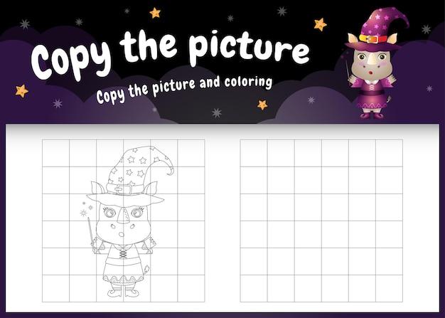 Copiez l'image du jeu pour enfants et de la page à colorier avec un rhinocéros mignon utilisant un costume d'halloween