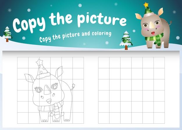 Copiez l'image du jeu pour enfants et de la page à colorier avec un rhinocéros mignon utilisant un costume de noël