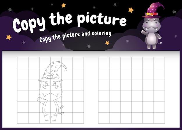 Copiez le jeu d'enfants et la page à colorier avec un hippopotame mignon utilisant un costume d'halloween