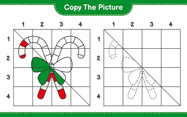 Copiez le jeu de feuille de calcul éducatif d'image de candy canes avec ruban en utilisant des lignes de grille