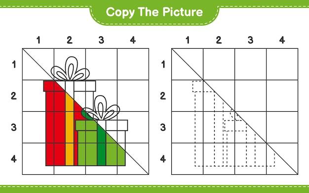 Copiez le jeu de feuille de travail éducatif d'image de coffrets cadeaux en utilisant des lignes de quadrillage