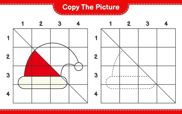 Copiez le jeu de feuille de travail éducatif d'image de santa hat en utilisant des lignes de grille