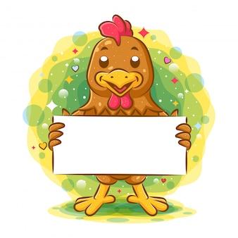 Coq brun debout et tenant du papier vierge