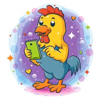 Coq debout tenant un téléphone intelligent