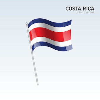 Costa rica, agitant le drapeau isolé sur fond gris