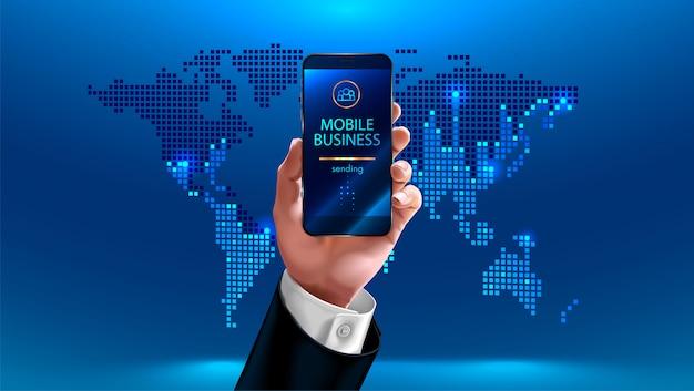 Costume d'affaires tenant un téléphone portable à la main sur la carte du monde